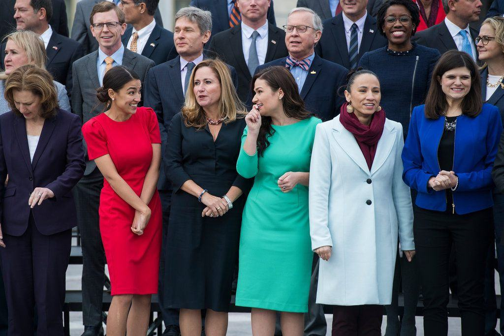 Members-elect, front row from left, Kim Schrier, D-Wash., Alexandria Ocasio-Cortez, D-N.Y., Debbie Mucarsel-Powell, D-Fla., Abby Finkenauer, D-Iowa, Sharice Davids, D-Kan., Haley Stevens, D-Mich., and other members of the incoming freshman class, pose for a photo on the East Front of the Capitol on Nov. 14. (Tom Williams/CQ Roll Call)